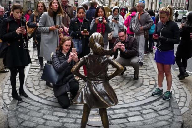 Fearless Girl creator State Street comes in for media scrutiny for 'ironic' gender inequality settlement