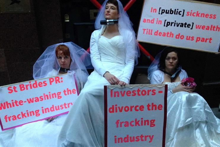 Anti-fracking protestors dressed as brides chain themselves to London PR firm door