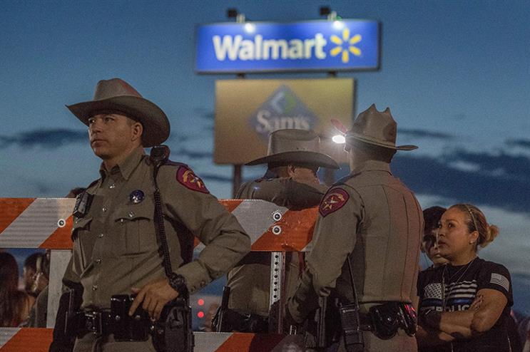 Texas State Troopers keep watch at a makeshift memorial for victims of the shooting that killed 22 at an El Paso, Texas WalMart in August. (MARK RALSTON/AFP via Getty Images)