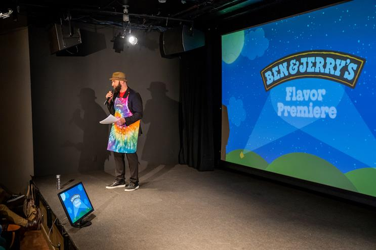 Greenwood speaks to the crowd at a Ben & Jerry's flavor reveal event.