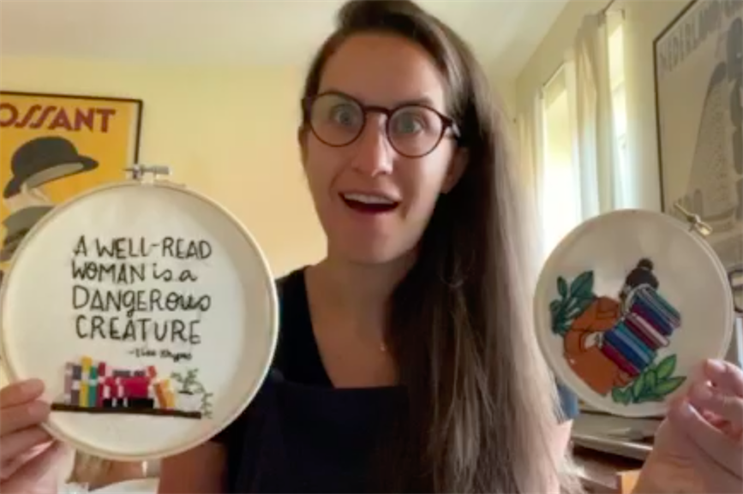 Caption: Random House's Sophie Vershbow shows off her needlepoint skills.