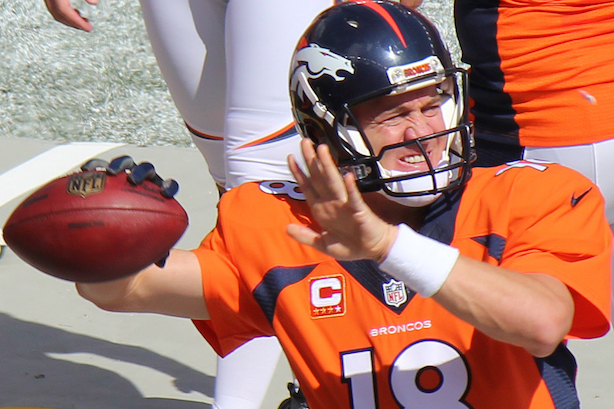 """Peyton Manning practices on the sidelines during a September 2014 game. (""""Peyton Manning 2014"""" by Jeffrey Beall - Flickr. Licensed under CC BY-SA 2.0 via Wikimedia Commons)"""
