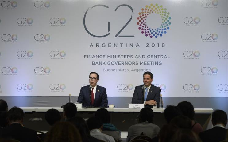 L-R: Treasury Secretary Steven Mnuchin with Sayegh at the G20 in March 2018. (Photo credit: Getty Images).