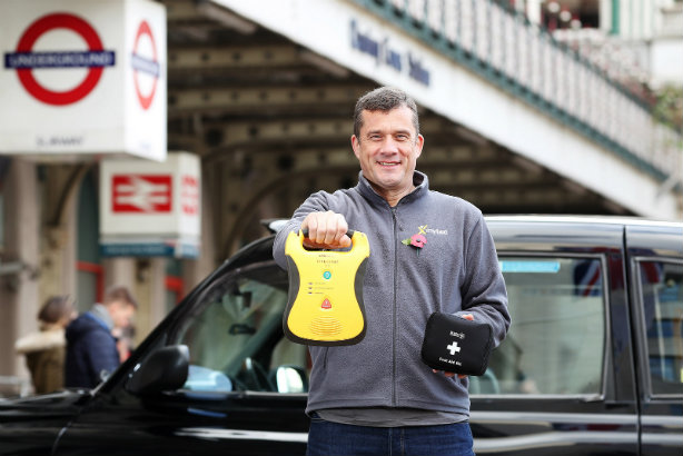 London black cab driver John Hamilton with first-aid kit and defibrillator (©PA)
