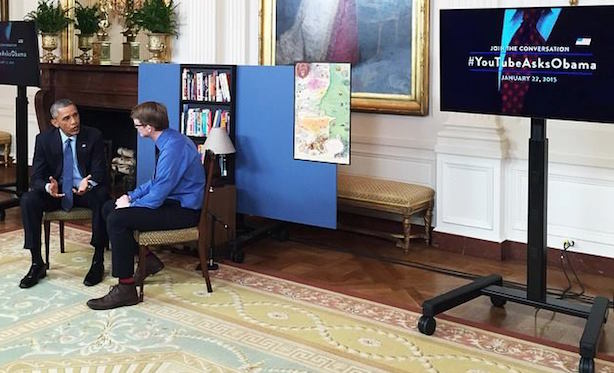 The president with YouTube personality Hank Green