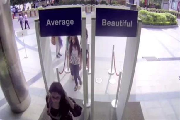 women walking through doors marked Average or Beautiful for the Dove real beauty campaign