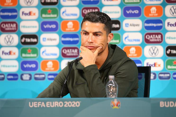 Soda-less Cristiano Ronaldo talks with the media at Euro 2020. (Photo credit: Getty Images).