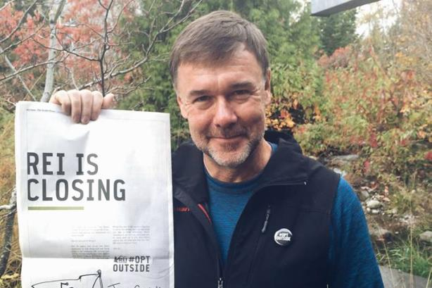 REI chief Jerry Stritzke probably wasn't smiling as he was quizzed by Redditors about employment policies (Image via REI's Facebook page).