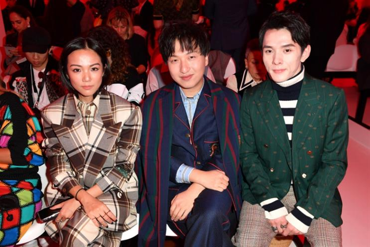 """Handbag influencer Tao Liang (middle) aka Mr Bags can generate """"half a million dollars in sales in a couple of minutes"""" for brands"""