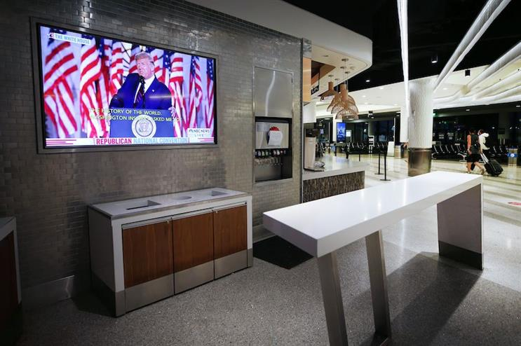 President Donald Trump's acceptance speech at the Republican National Convention plays at a mostly empty Los Angeles International Airport. (Photo credit: Getty Images)