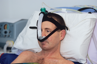Patient with motor neurone disease on a ventilator (Photo: SPL)