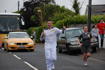 Dr Nigel Hart carries the Olympic torch