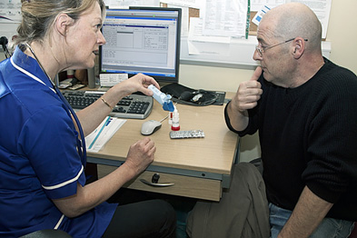 Practice nurse discussing inhaler use with a patient with COPD (Photograph: SPL)