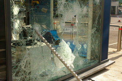 Rioting in London has led to shop fronts being smashed (above) and GP practices being broken into (Photograph: Rexfeatures)
