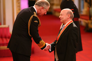 Sir Peter receiving his knighthood from Prince Charles