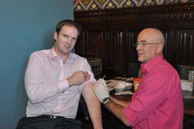 Health minister Dr Dan Poulter receives his flu vaccine at the clinic (Photo: Chris Raphael)