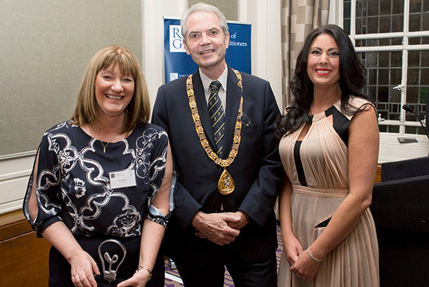 Darwen Health Centre's business manager Ann Neville (left) and advanced nurse practitioner Debbie Yates receive the RCGP's Bright Ideas award from college president Dr Terry Kemple