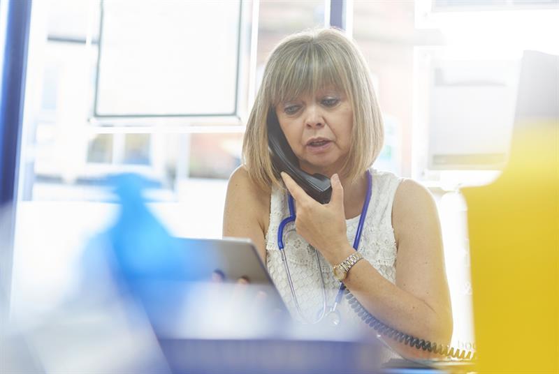 Phone consultation (Photo: Martin Prescott/Getty Images)