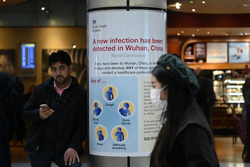 A Public Health England poster in Heathrow's Terminal 4 (Photo: Daniel Leal-Olivas/Getty Images)