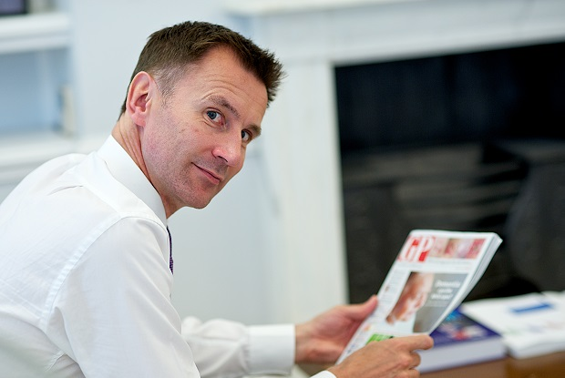 Jeremy Hunt reading GP magazine (Photo: JH Lancy)