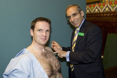 Semi-naked health minister receives flu jab.