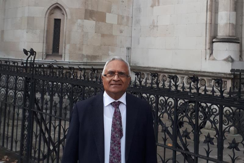 Dr Mehta outside High Court, London