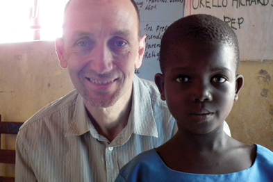 Dr Heyes with one of the children sponsored by the Global Care in Uganda