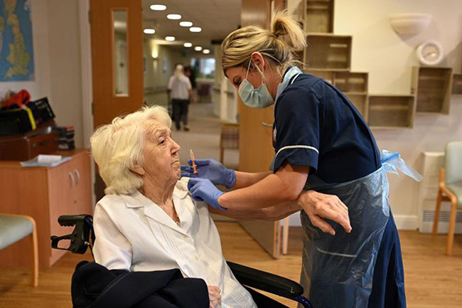 Practice nurse Victoria Parkinson gives a COVID-19 jab to a care home resident in Wigan (Photo: Oli Scarff/AFP/Getty Images)