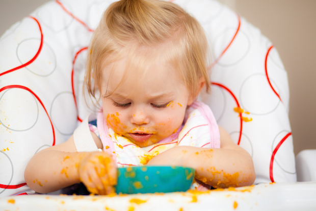 NICE recommends that underweight children are allowed to be 'messy' with food and encouraged to feed themselves (Photo: iStock)