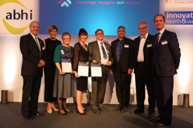 Staffordshire GP Dr Ian Greaves (fourth from right), who led development of the Memory First scheme, receives the NHS award with members of the team (Photo: Chloe Lynton)
