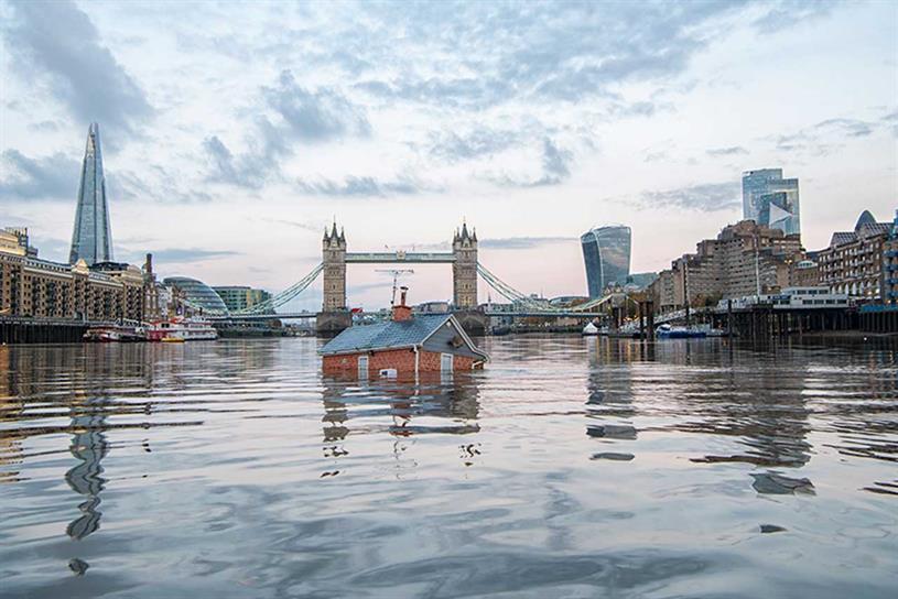 Extinction Rebellion sends 'sinking house' down Thames as flooding devastates north