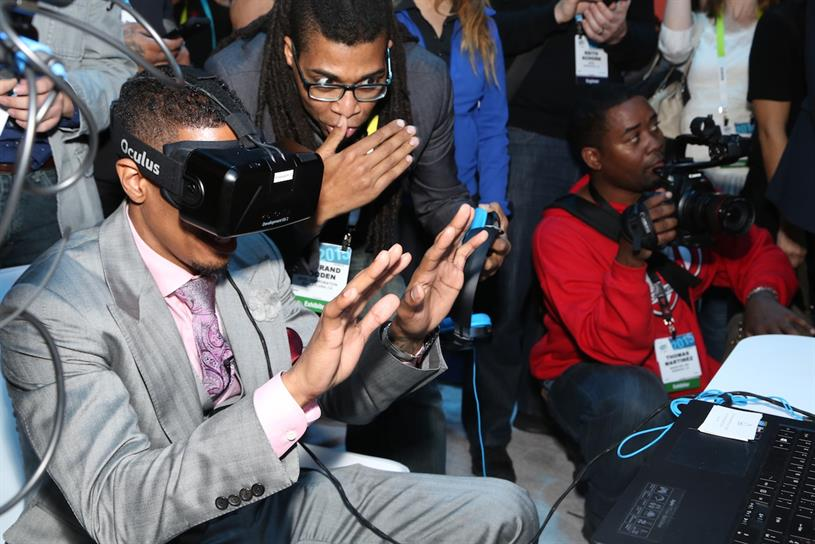 Oculus Rift: US TV host Nick Cannon tries out the technology at CES
