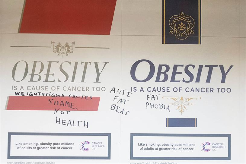 Cancer Research: poster graffitied at Richmond Tube station in London