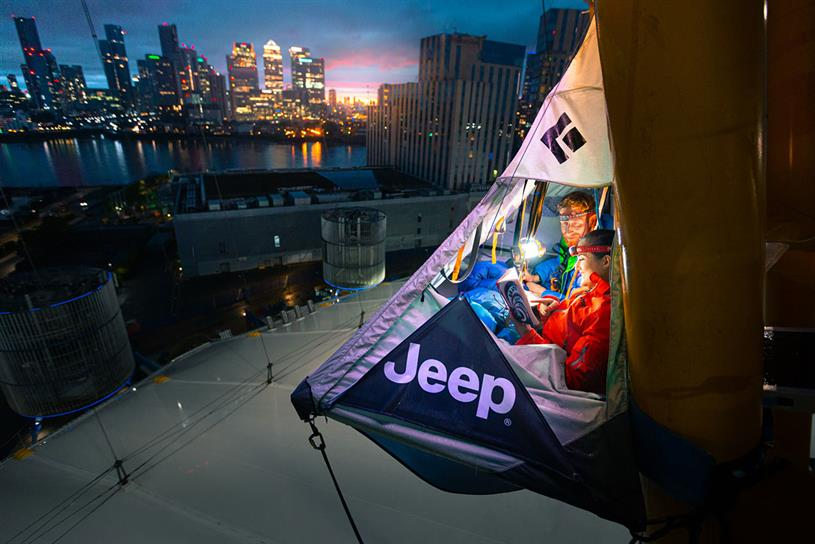 Jeep: the tent is attached to one of the yellow pylons of The O2