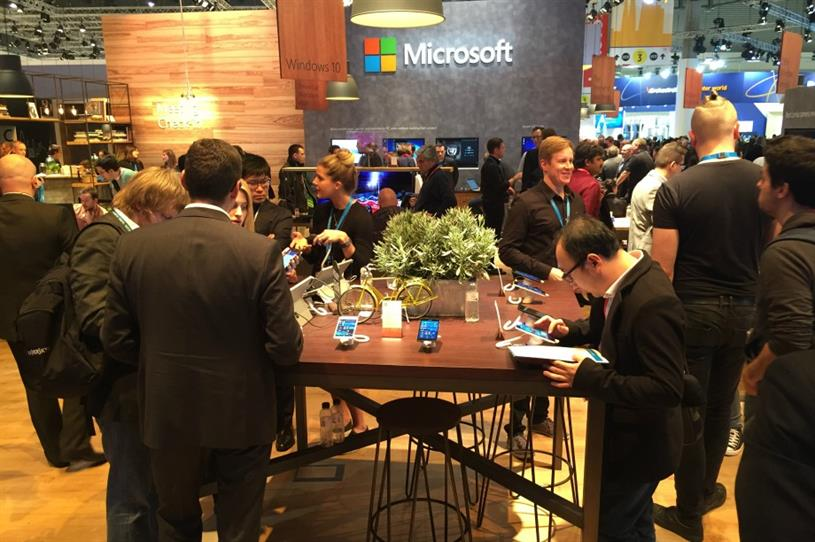 Microsoft, Huawei and Sony each used natural wood textures to add warmth to their stands