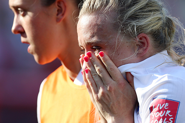 Laura Bassett is consoled after scoring an own goal in England's semi-final defeat by Japan