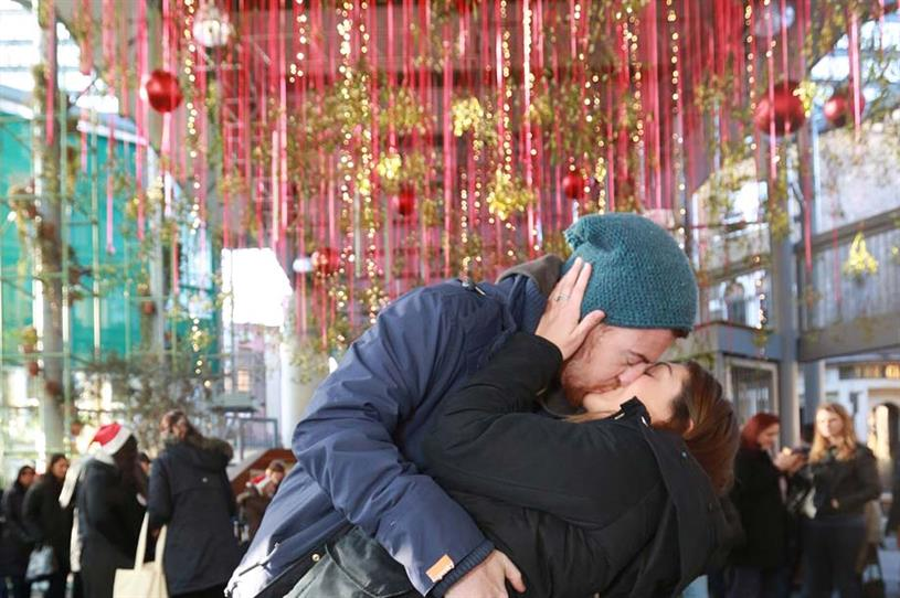 Christmas shoppers kiss to power Borough Market's festive lights display