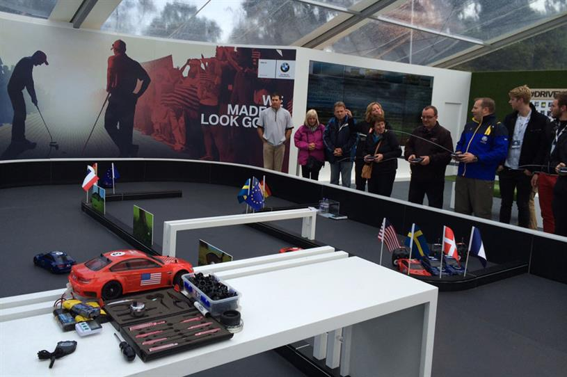 The BMW activation will let guests race in miniature cars