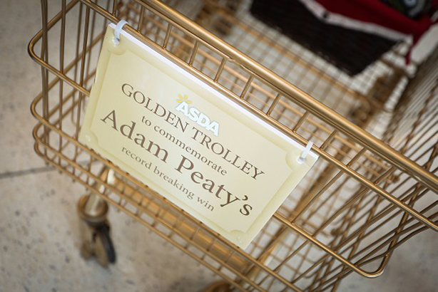Asda in Uttoxeter, Staffordshire created a golden trolley to commemorate swimmer Adam Peaty's gold medal