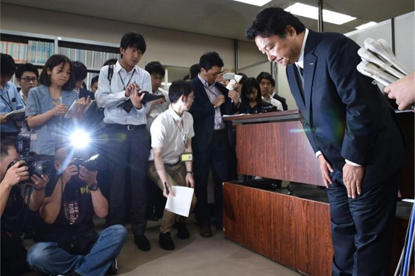 Dentsu president Toshihiro Yamamoto bows at a press conference in Tokyo (AFP)