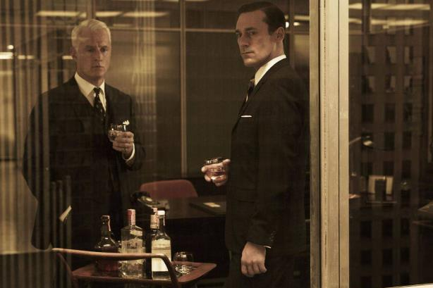 Mad Men: TV drama's Roger Sterling and Don Draper were rarely without a drink in their hands (Picture: AMC/Facebook)