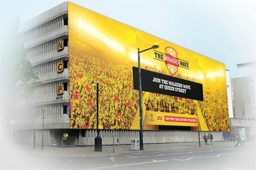 Rendering of the #WalkersWave on digital OOH billboard outside the National Stadium of Wales