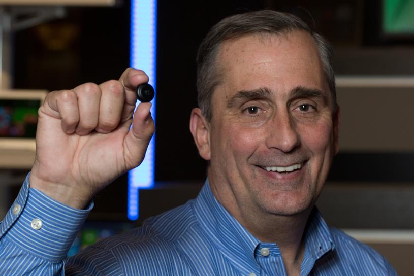 Intel CEO Brian Krzanich holds a wearable-tech prototype.