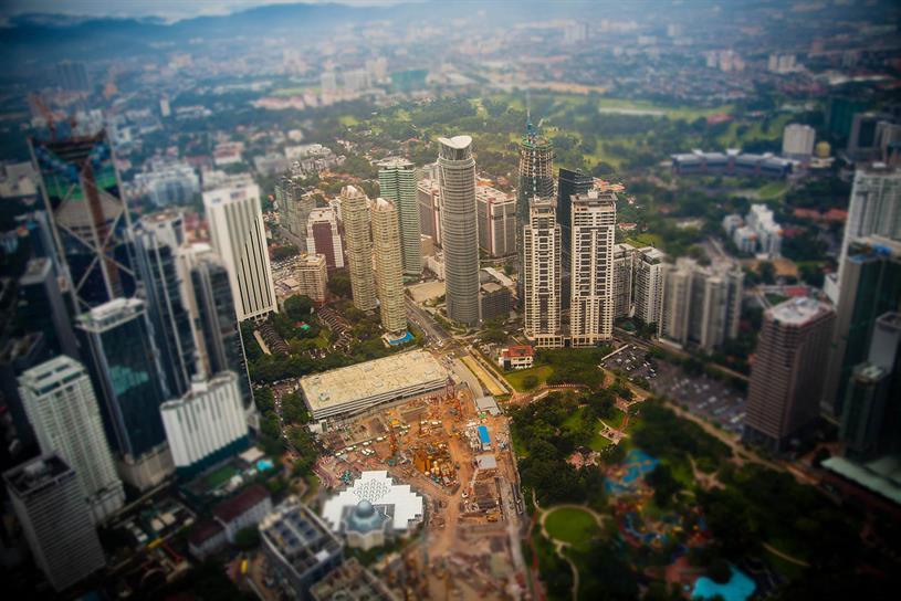 Kusls Lumpur, Malaysia; view from inside the Petronas Twin Towers. (Photo courtesy Tatiana Vdb via Flickr)