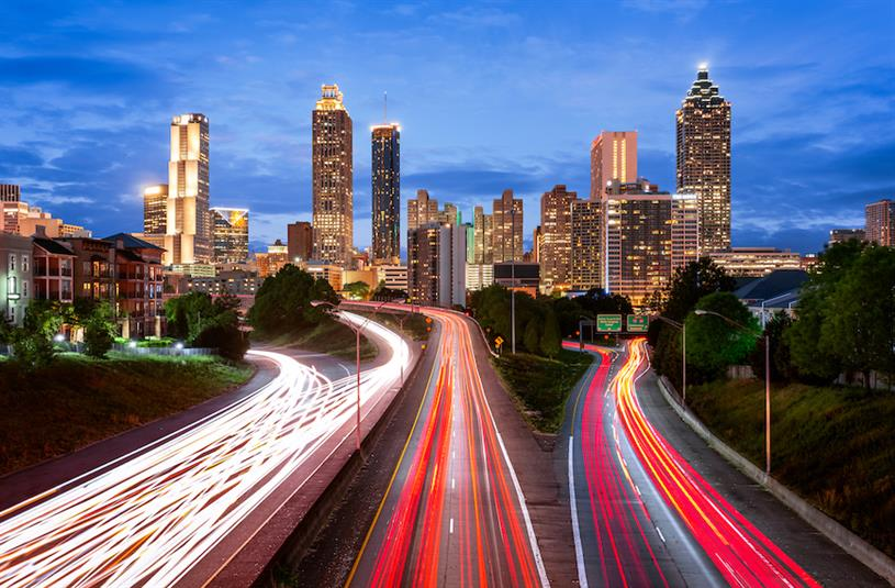 Atlanta-based companies like Coca-Cola have been under pressure to oppose the state's new restrictive voting law. (Photo credit: Getty Images).