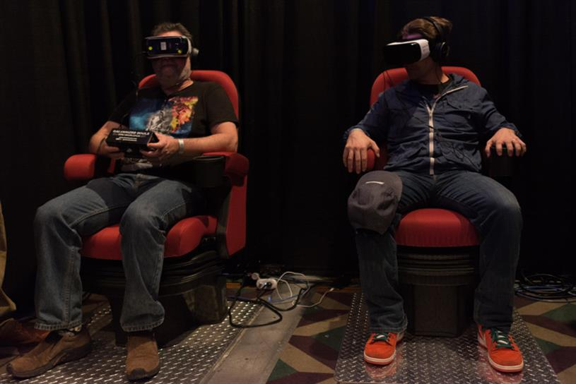 Men tries virtual reality Samsung Gear VR headset at 2016's VRLA.