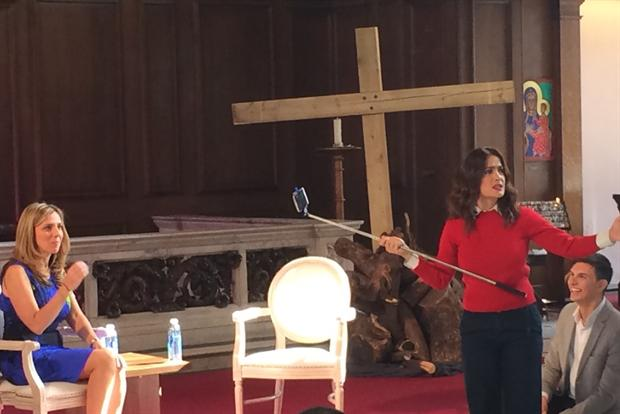 Salma Hayek and Facebook's Nicola Mendelsohn prepare for an audience selfie at Advertising Week Europe.