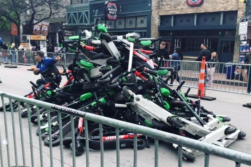 A pile of confiscated scooters after police closed several roads (Picture: @drafthouseaustin/Instagram)