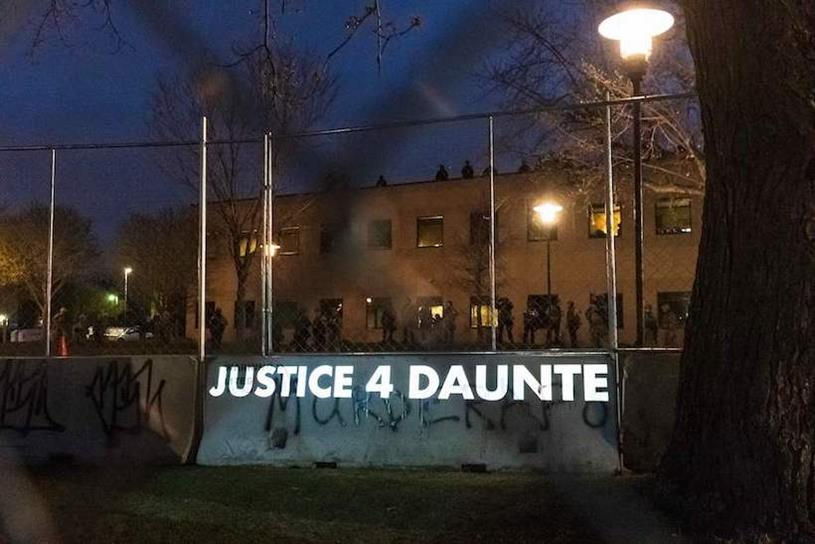 """""""Justice 4 Daunte"""" is projected near a police precinct in Brooklyn Center, Minnesota, this week. (Photo credit: Getty Images)."""