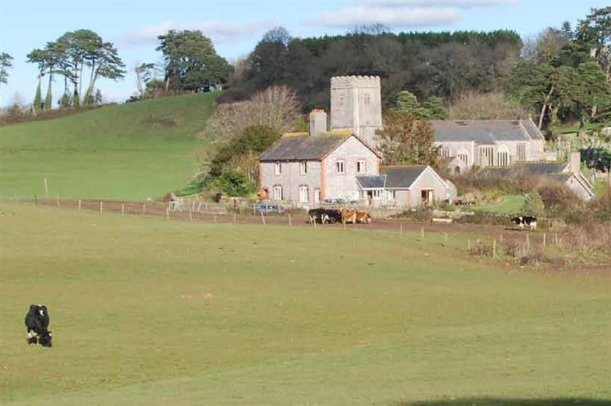 Existing buildings that would be retained on the site of the proposed hotel and urban extension in Devon (Image: Anthony, Steven and Jill Rew)